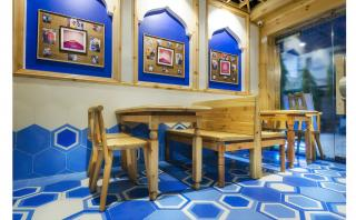Customized Pine wood furniture offsets the blue color creating a warm balance to the cool tones of blue