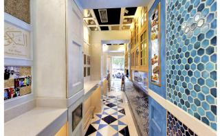 Bold geometric floor with kitchen facade of Rule the Rolls